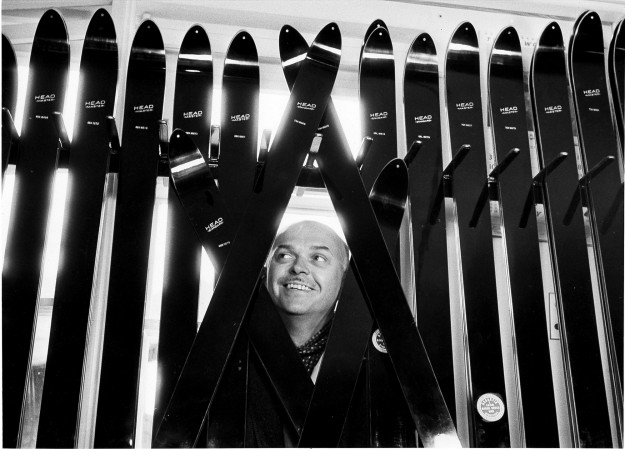 NMAH Archives Center Howard Head Papers 0589 Box 1 Folder 12 Howard Head peeking through a display of Head Skis